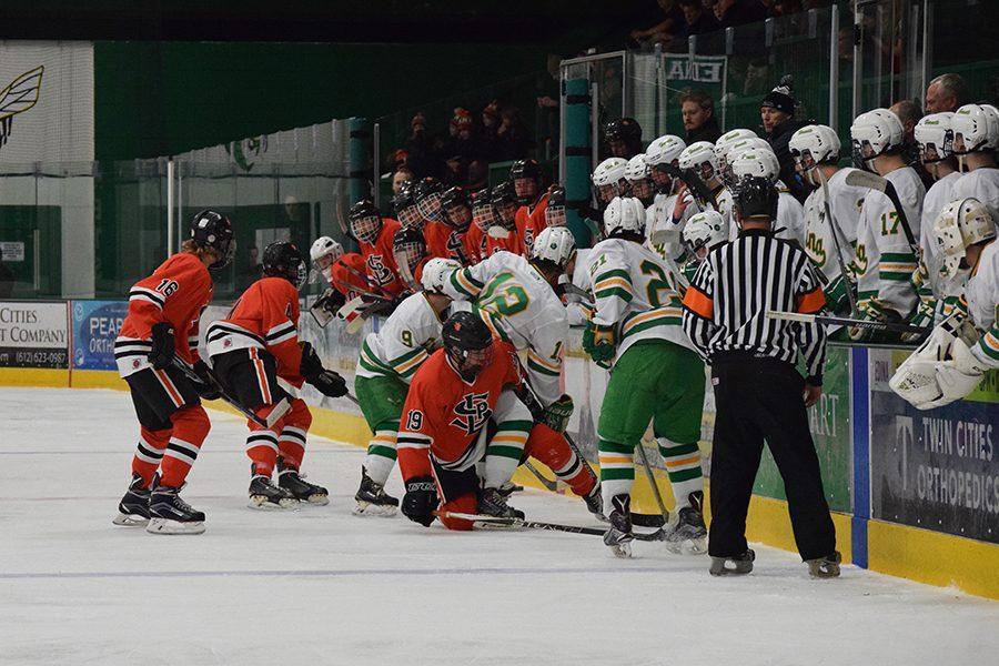 Senior+Austin+Stafne+and+juniors+Ryan+Klaers+and+Jonny+Sorenson+fight+for+control+of+the+puck.