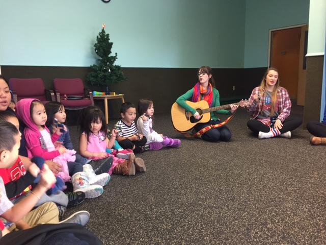 DECA members sing holiday songs with the preschoolers from Family Partnership. They attended the preschool Dec. 20.