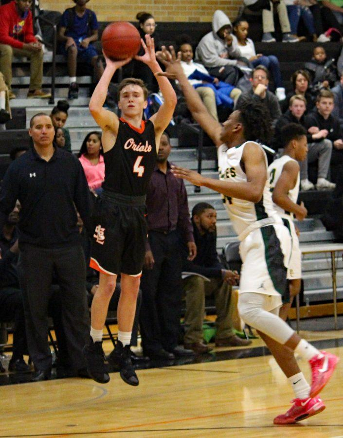 Junior, Joey Whitlock, shoots from the three point point line during their game against Park Center Dec. 6.