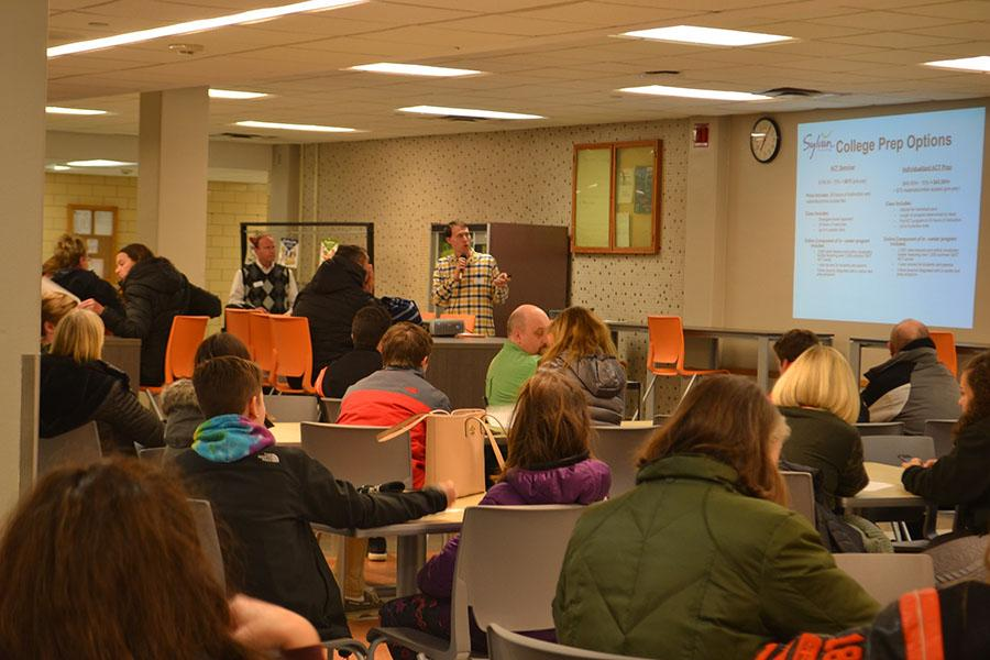 A Sylvan Learning representative speaks to parents about the reults of the practice ACT on Jan. 5.