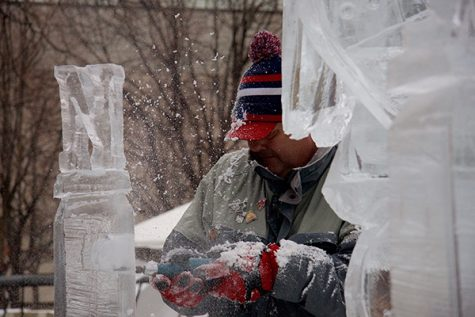 An artist works on his ice sculpture at the 2017 St. Paul Winter Carnival. The Carnival is located at Rice Park in St. Paul.