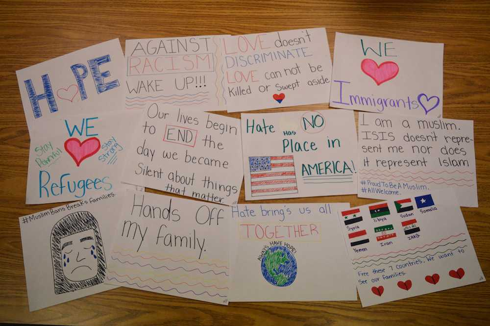 """Signs of change: """"I didn't want people to feel hurt so I just thought if we put (the signs) up, at least someone's going to smile."""" -Zahra Mohamed, freshman."""