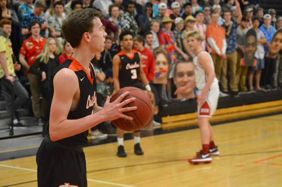 Junior guard Joey Whitlock prepares to throw the ball inbounds from the baseline. The Orioles defeated the Benilde-St. Margarets Red Knights 77-57 Feb. 24, which improved the Orioles' record to 12-12.