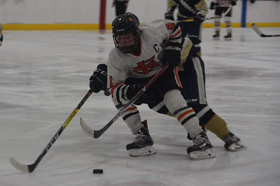 Senior+captain+Bauer+Neudecker+charges+the+net+and+takes+a+shot+that+missed+wide+right.+Neudecker+had+two+assists+in+the+Orioles%27+Feb.+7+3-0+victory+against+Chanhassen.+