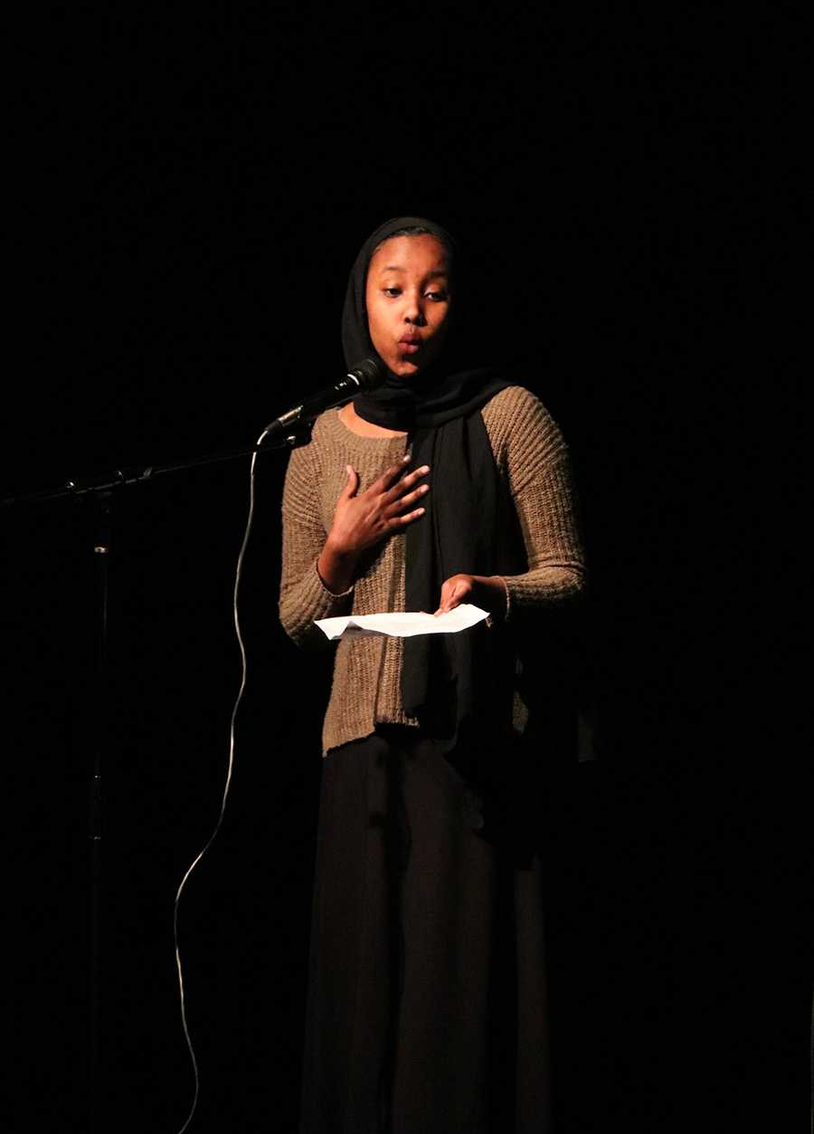 Iqbal+Abdi+recites+a+poem+during+the+Black+History+Month+show+on+Friday.+Students+at+the+show+performed+songs+and+poems+about+leaders+in+the+Black+community.