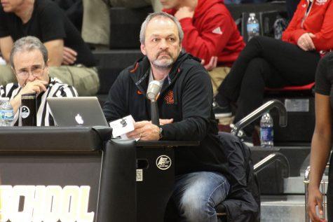 Social studies teacher announces girls' basketball