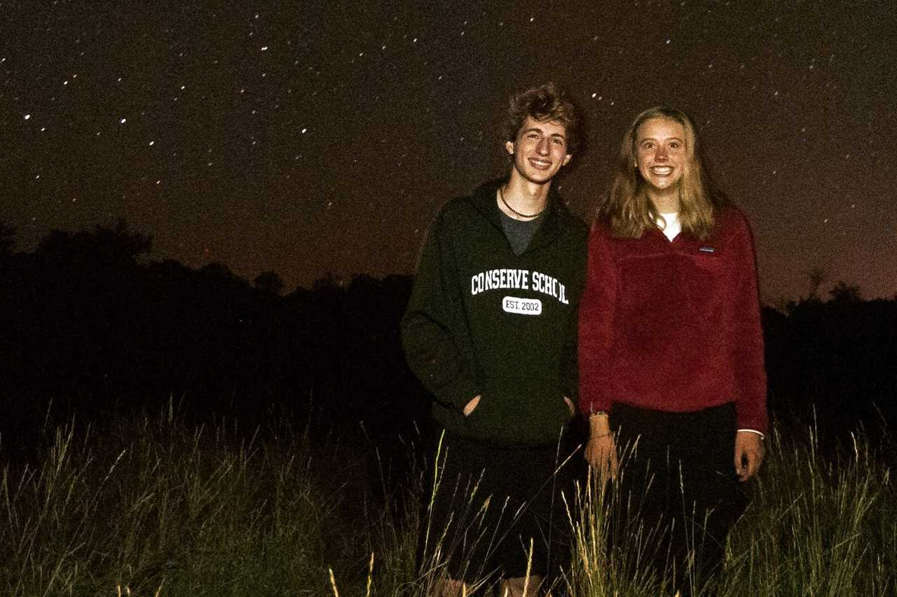 Juniors Caroline Green and Lukas Wrede stand under the Northern Lights. They both returned to Park in Dec. after spending the past semester at Conserve School.