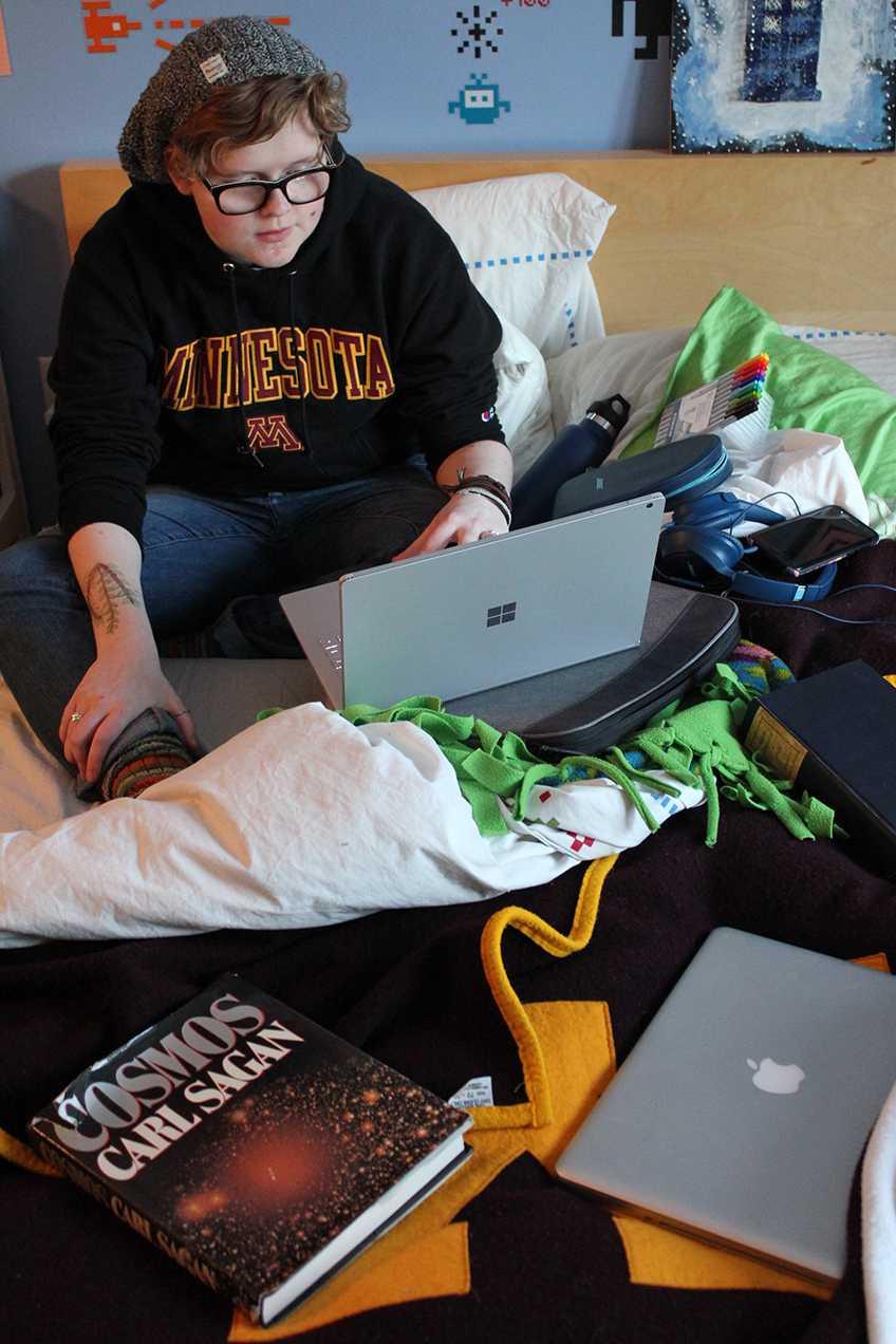 Senior Freja Olsen prepares her astronomy project for Science Olympiad.
