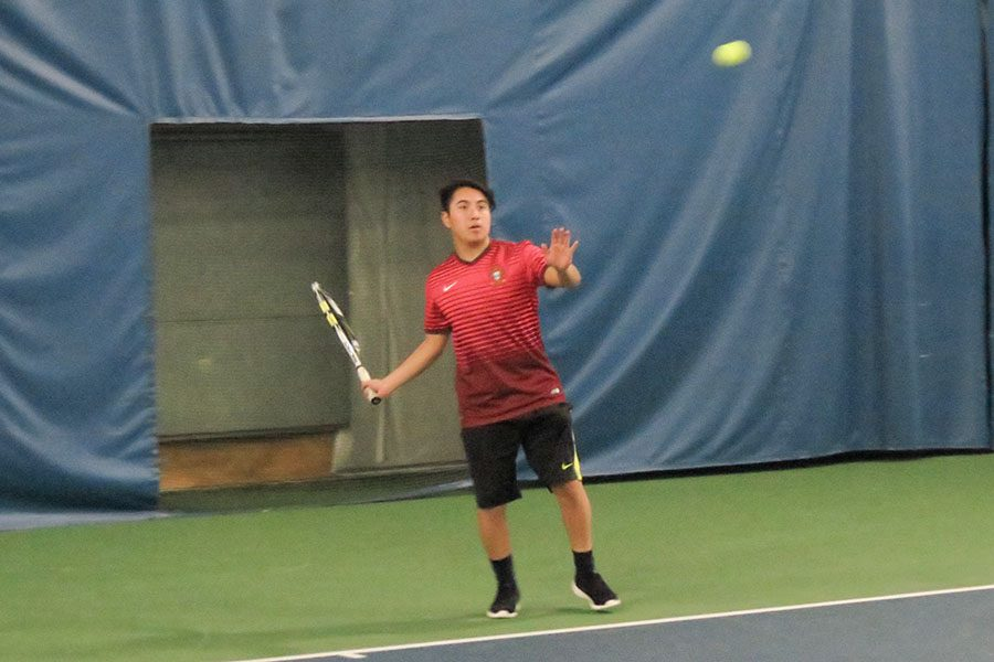 Senior+Oscar+Laing+prepares+to+strike+the+ball+during+captains+practice+at+Williston+Fitness+Center.++Tryouts+will+take+place+from+3+p.m.-5%3A30+p.m.+April+3-5+at+the+Park+tennis+courts.%0A