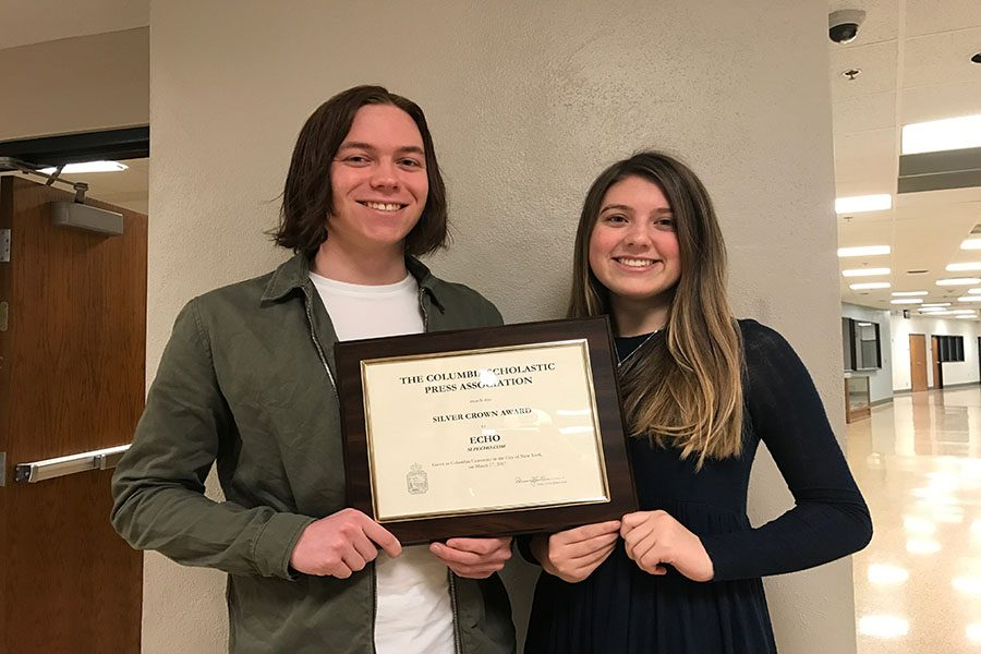 Echo+editor-in-chief+Maggie+Bahnson+and+editor-in-cheif+Ethan+Brown+hold+a+Columbia+Scholastic+Press+Association+Silver+Crown+Award.+Echo+adviser+Lori+Keekley+accepted+the+award+on+her+trip+to+New+York%2C+New+York.+