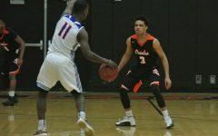 Boys' basketball beats Washburn in Section playoffs