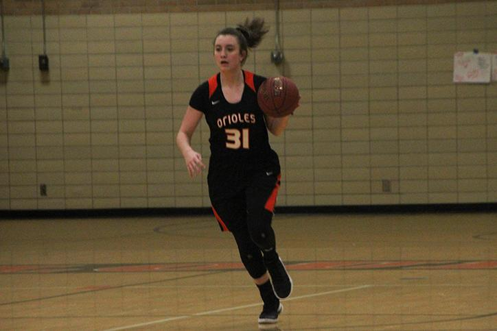Freshman+Shayla+Miller+dribbles+the+ball+in+her+Feb.+22+game+against+Blake.+According+to+the+StarTribune+Girls%27+Basketball+Hub%2C+Miller+averages+10.3+points+per+game+with+a+total+of+258+points+in+the+2016-2017+regular+season.