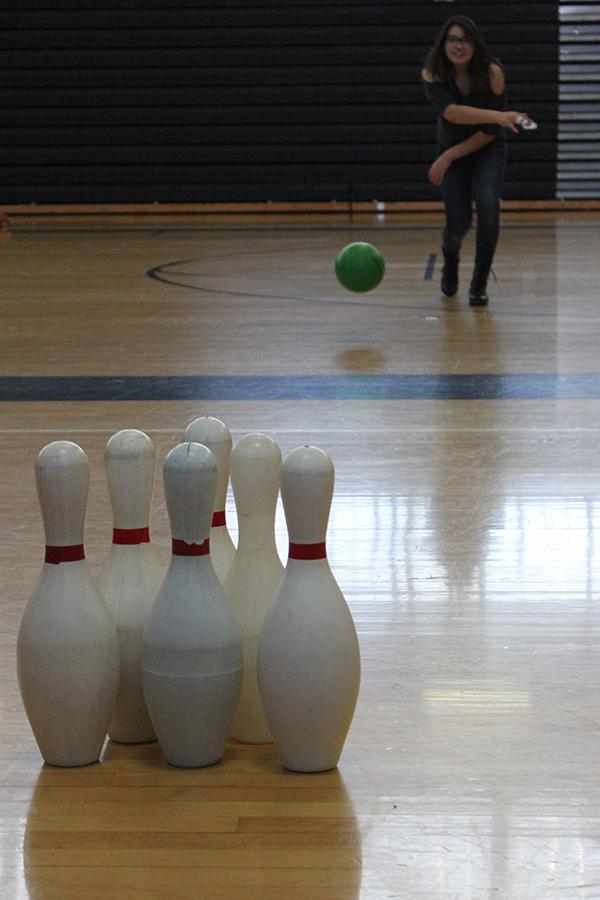 Stay in shape: Junior Vanessa Zarate attempts to knock down bowling pins during her new moves class March 16.