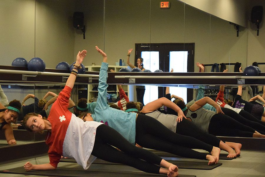 Junior+Brooklyn+Donelson+practices+a+side+plank+with+other+team+members+during+a+barre+class+Feb.+27.+The+synchro+season+starts+March+6.