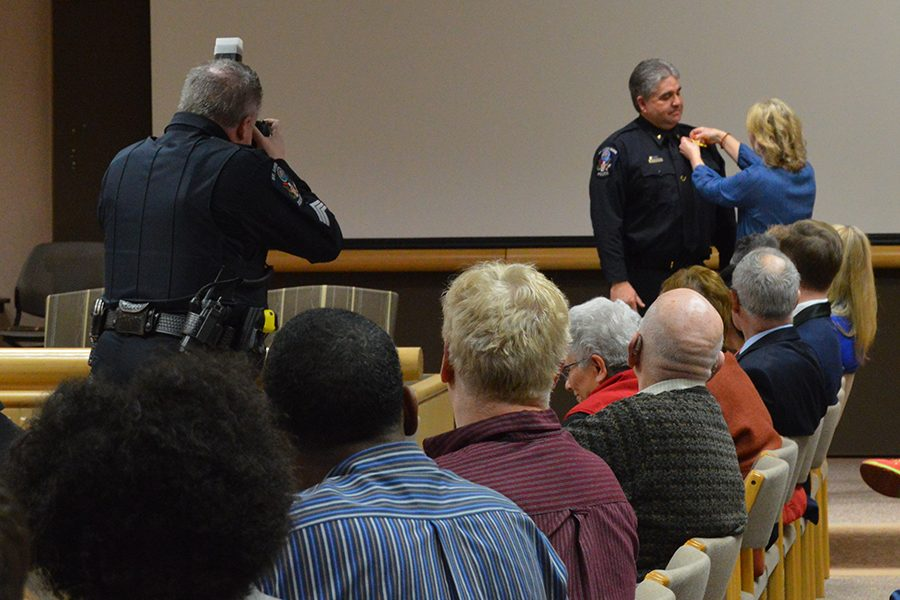 Former Lieutenant Mike Harcey received a badge after being sworn in as Chief of police at St. Louis Park City Hall.