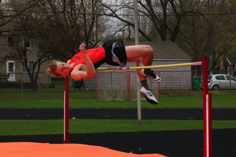 Senior+captain+Owen+Geier+contorts+his+body+to+clear+the+high+jump+at+the+meet+on+Tuesday%2C+April+18.+Geier+finished+first+in+high+jump+along+with+the+110+meter+hurdles.+St.+Louis+Park+came+in+third+place+in+the+meet+with+82+points.