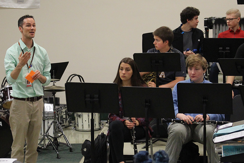 Band+teacher+Steven+Schmitz+talks+with+the+band+following+their+performance+at+Edina+High+School+April+24.+The+band+received+a+superior+rating+at+the+competition.+