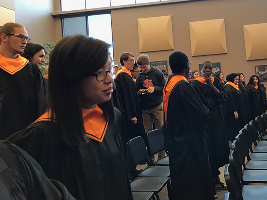 Choir rehearsing before their performance at Chanhassen High School Apr. 6. They sang 'Gloria', 'Baba Yetu' and 'Bar So Re'.