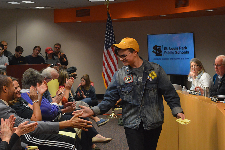 Freshman Mathew Loftus receives high fives after his speech at the school board meeting April 24. The Gender Sexuality Alliance and their supporters proposed a gender inclusive policy to the school board.