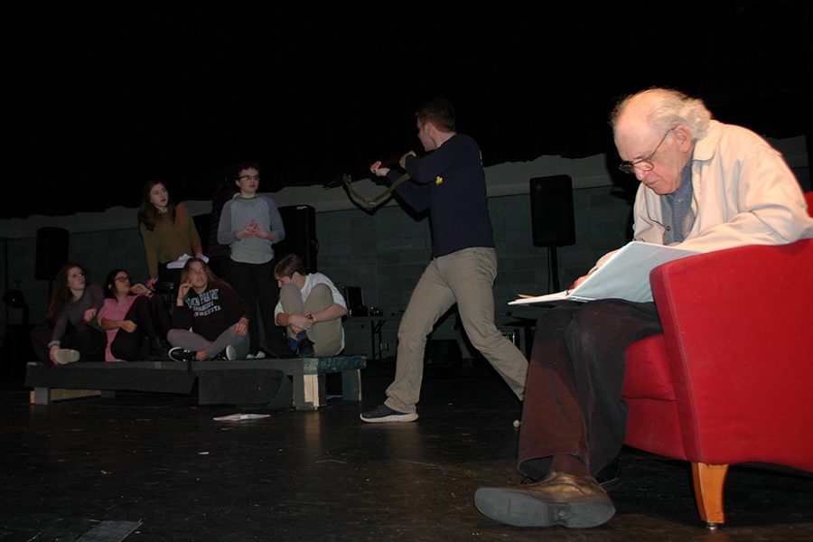 Holocaust survivor Charles Fodor narrates his story of being liberated as it is reenacted by senior Amira Stone and freshman Sofia Seewald and others behind him.