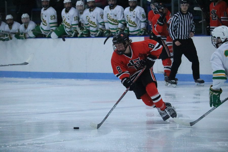 Senior Bauer Neudecker handles the puck February 25th at the second section game against Edina. Neudecker is currently playing in Fairbanks, Alaska for the Fairbanks Ice Dogs.