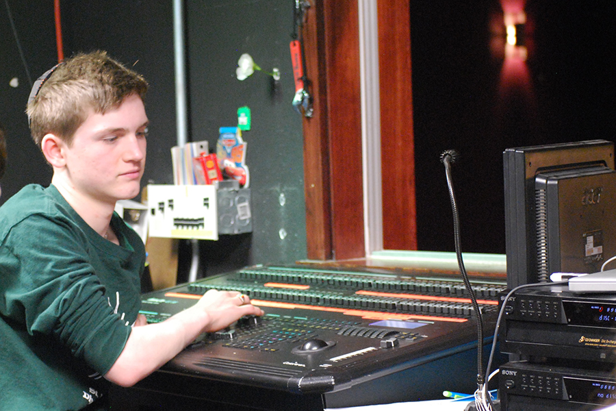 Junior Jake Henry cues lights for the spring play rehearsal on April 25. The spring play, Sense and Sensibility, plays on April 28 and 29 at 7 p.m. It shows April 30 at 2 p.m.