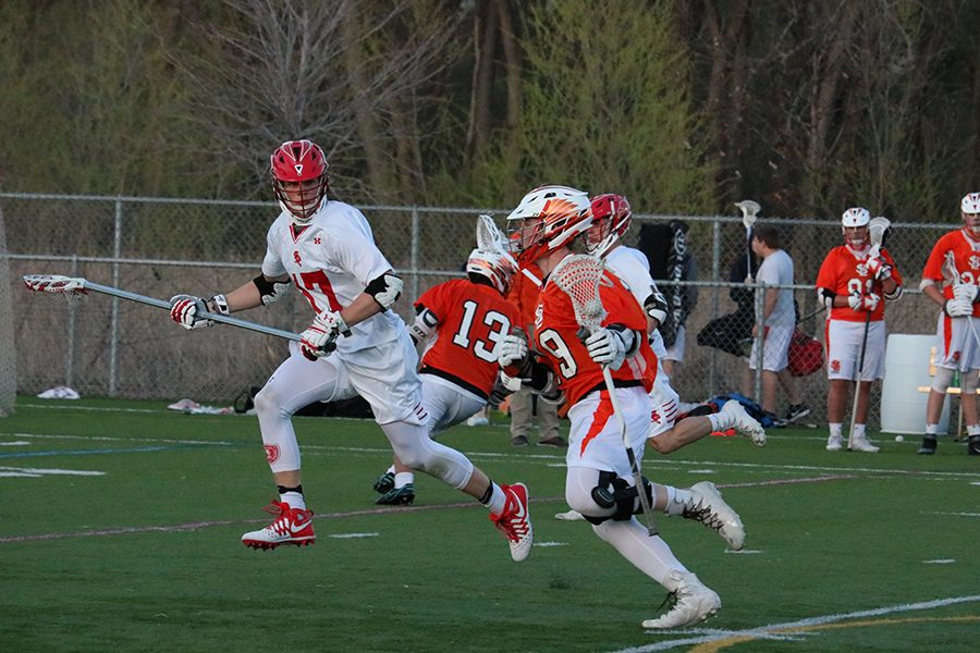 Senior+Captain+Brody+Ilstrup+carries+the+ball+down+the+field+in+an+attempt+to+shoot.+Ilstrup+scored+3+goals+in+Park%27s+19-4+loss+against+Benilde.