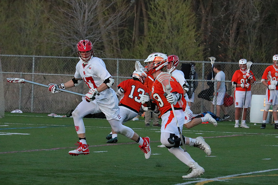 Senior Captain Brody Ilstrup carries the ball down the field in an attempt to shoot. Ilstrup scored 3 goals in Park's 19-4 loss against Benilde.