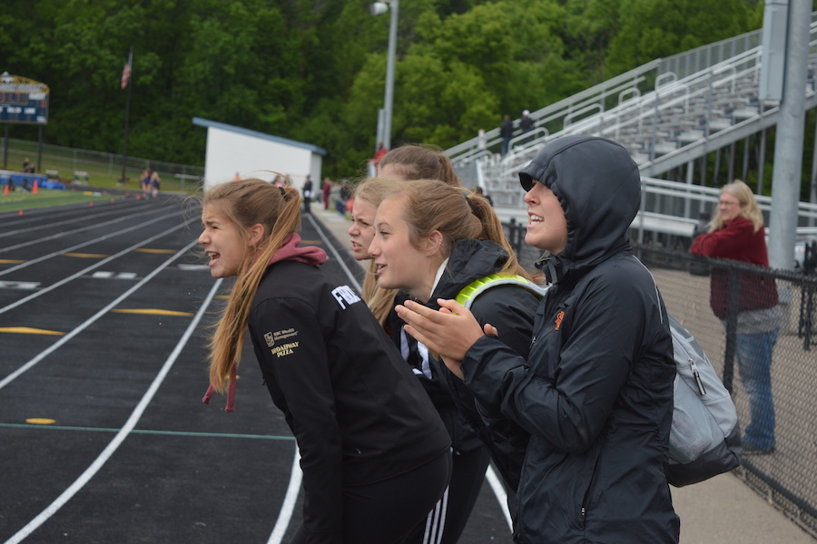 Seniors Samantha Baer and Stephanie Reuter and juniors Katie Fredrickson and Lindsey Prestholdt cheer on their teammates during the two mile run. The team's next meet takes place at 3:30 p.m. May 22 at Richfield Highschool.