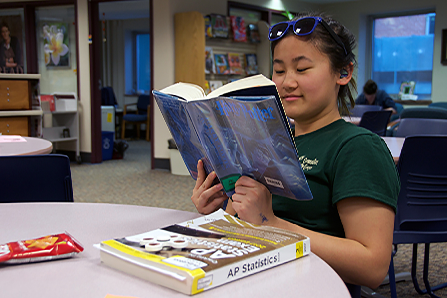 Student Anna Kasper sits in the Library Media Center between classes to spend time reading.