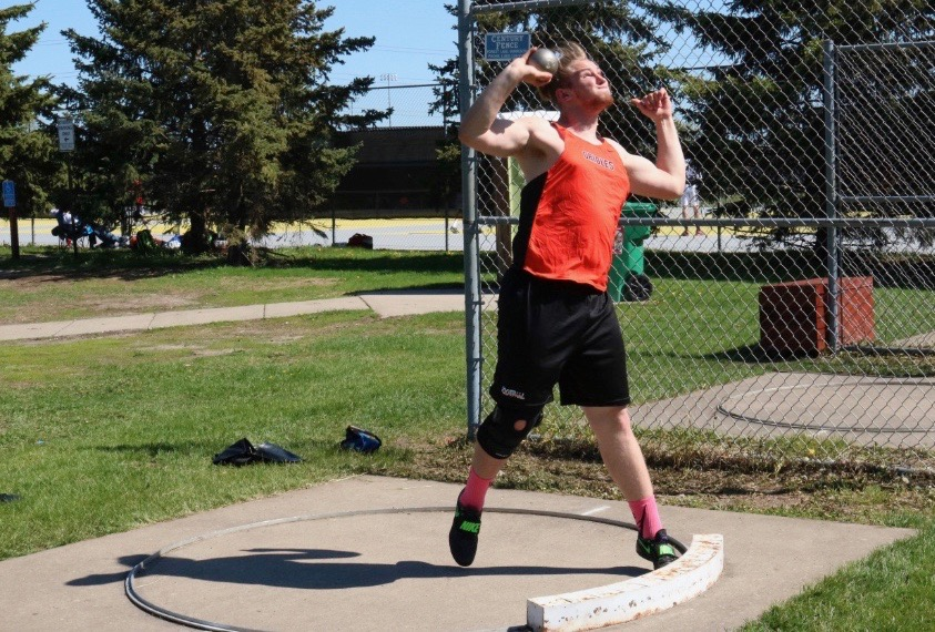 Senior+Mike+Donahue+practices+his+shot-put+throw+at+practice+May+11.+Donahue+has+competed+as+a+thrower+since+his+freshman+year.