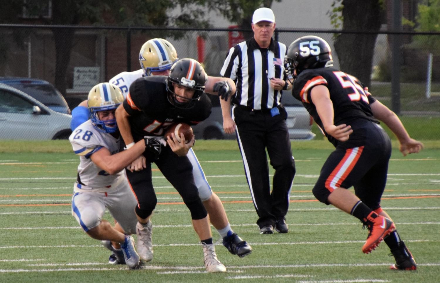 Senior varsity quarterback Jonny Sorenson attempts to break a tackle by Holy Angels' defense, Sept. 15.