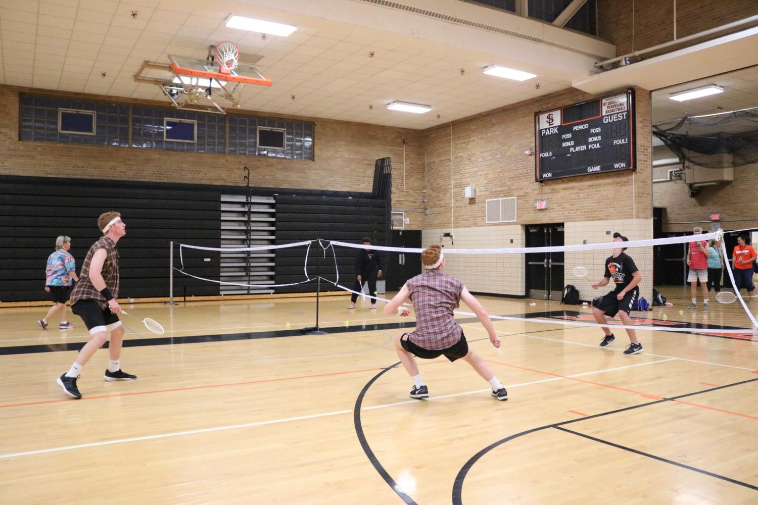 Seniors+Luke+Mobley+and+Shea+Pekarek+compete+during+a+round+of+badminton%2C+Sept%2C+12.+Tuesday+was+the+second+night+of+homecoming+events.