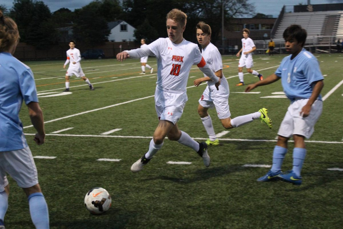 Zinidine Kroeten runs for the soccer ball while playing Jefferson Thursday night. The boys varsity team won 3-1.