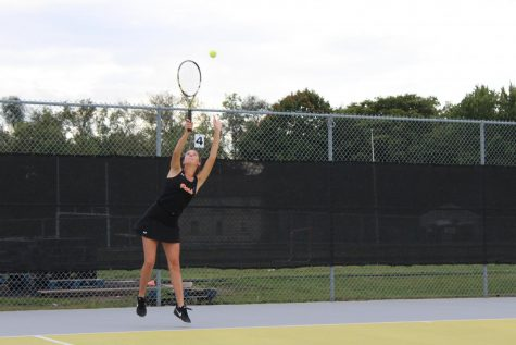 Junior Violet Huber serves the ball during a tennis match against Richfield, Sept. 28.
