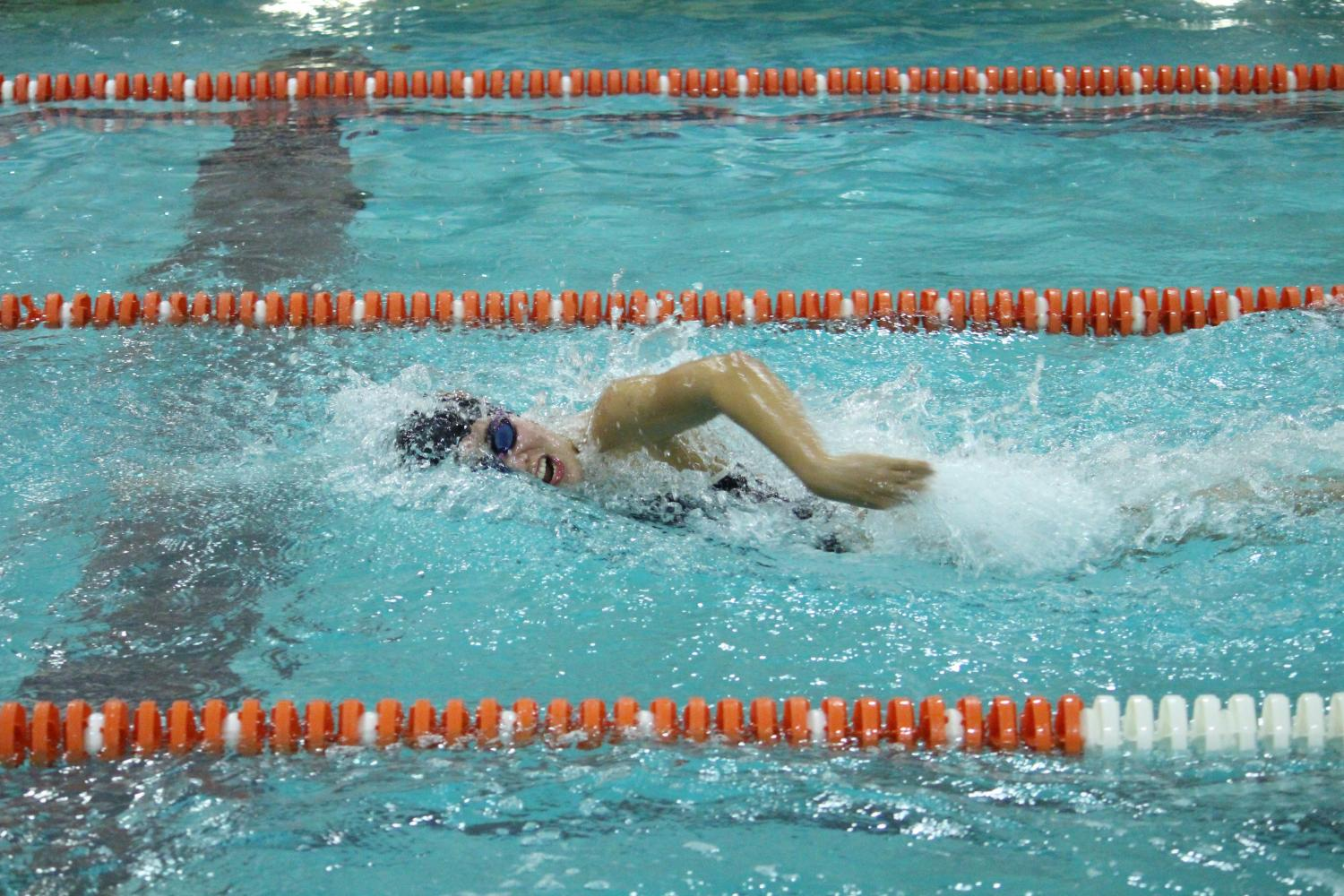 Junior Lexi Lee swims the 4x100 freestyle in their 25-69 loss to Chanhassen Sept. 14.