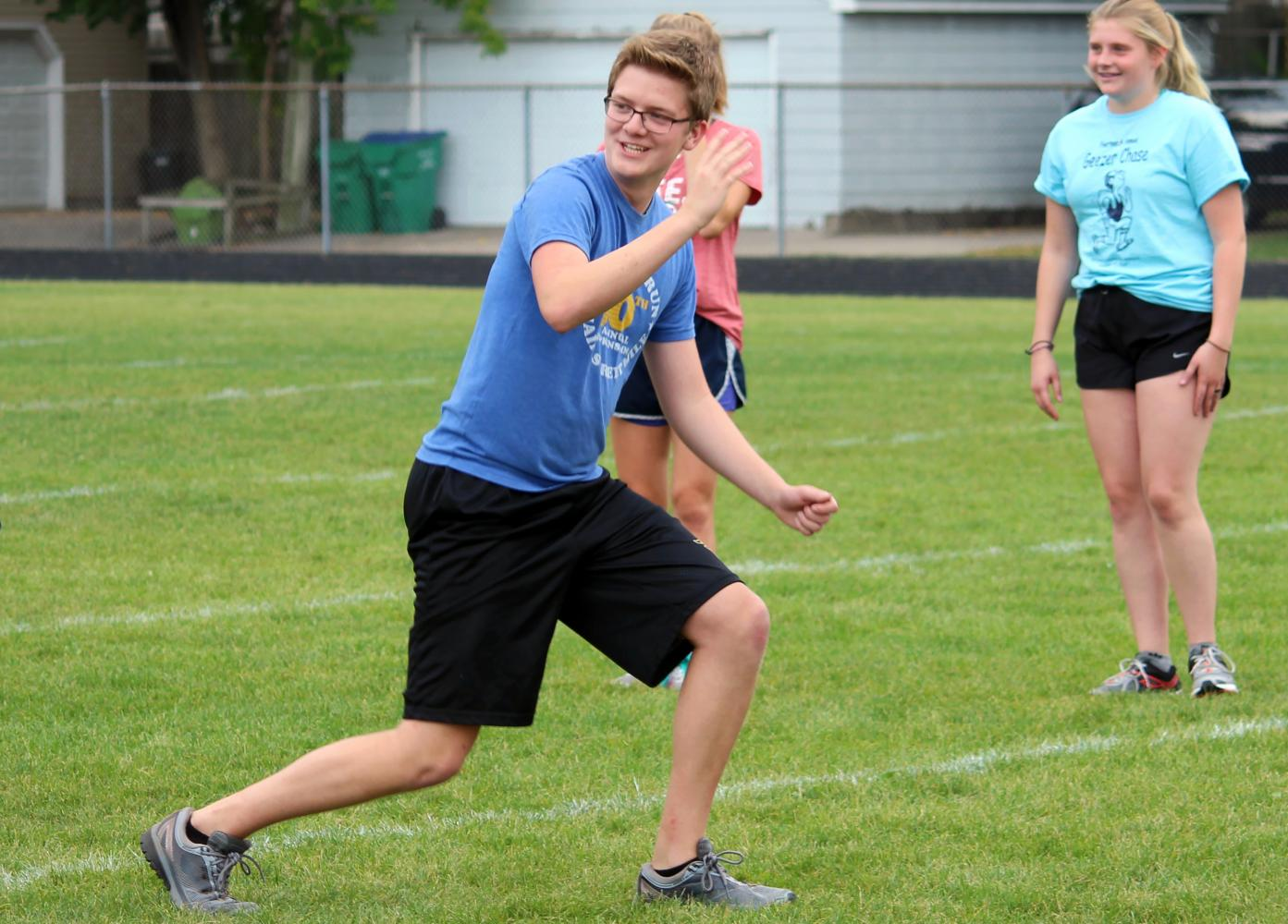 Senior Collin Perkins leads warm ups at the start of cross country practice Sept. 15.