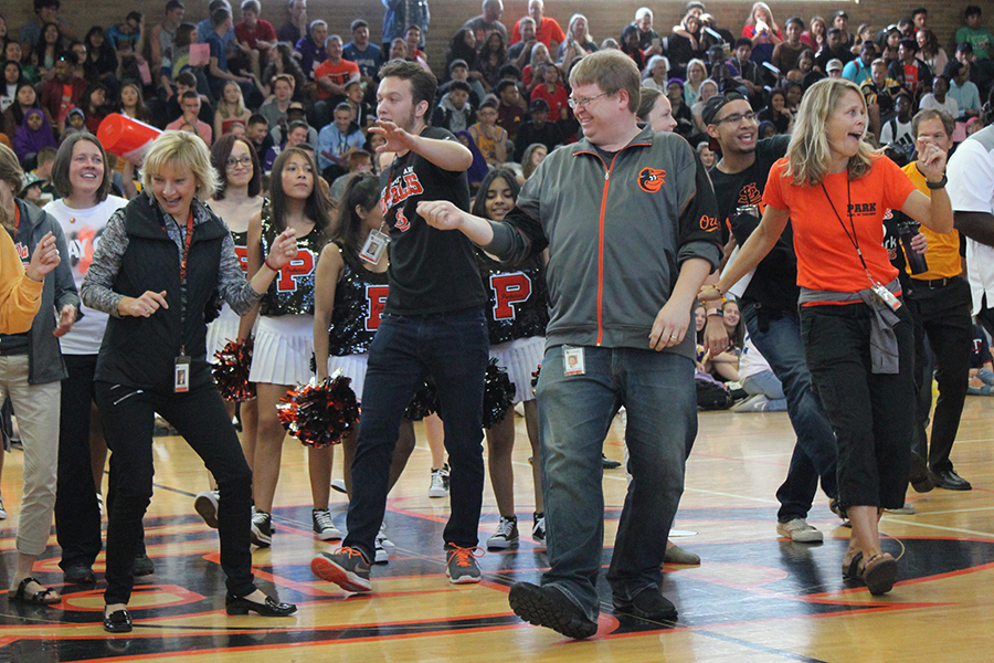 High school staff participate in the Cupid Shuffle at the Day One pep fest on September 5, 2018.