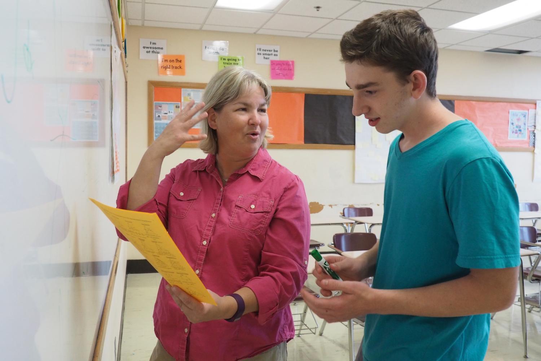 Math team member Eitan Weinstein and club adviser Kristin Johnson discuss math drills during their first meeting Sept. 18.