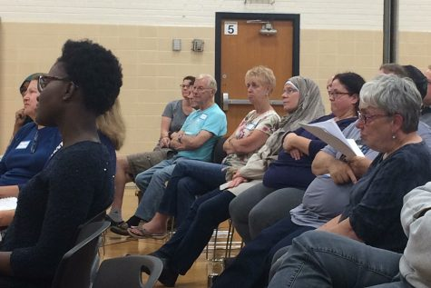 Park community members attentively listen to a speaker at a community meeting led by Muslim leaders, Sept. 19.