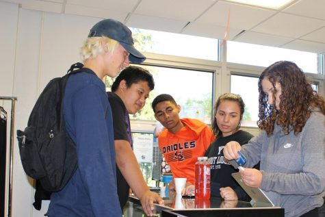 Storiole manager Maya Smith sells ICE drinks to freshmen during second lunch Sept. 27.