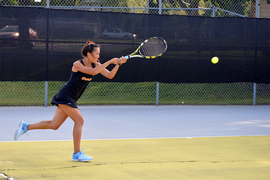 Junior+Susi+Hu+hits+a+cross-court+backhand+against+Robbinsdale+Cooper.+Hu+has+been+on+the+team+for+three+years+and+plays+in+the+fourth+singles+spot.+