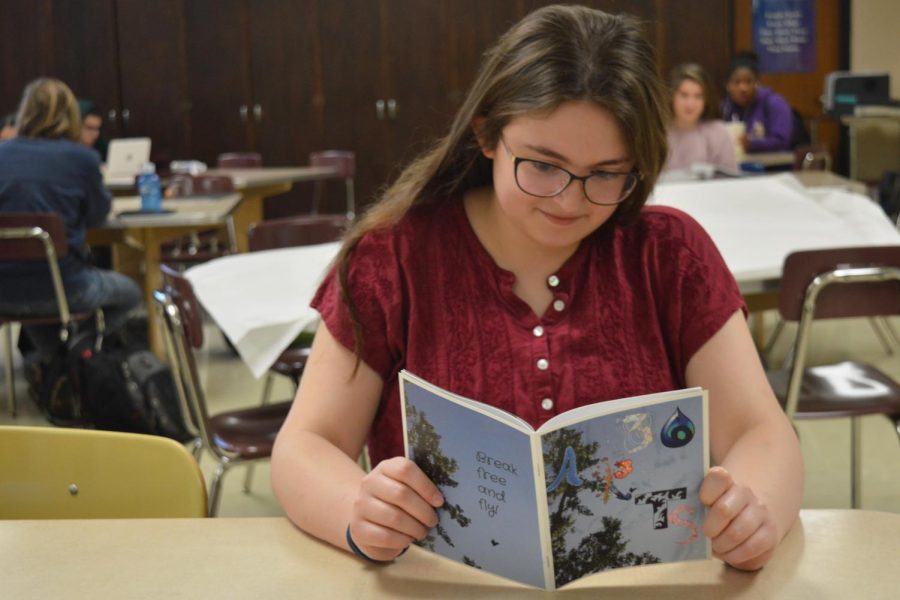 Senior Katie Steiner looks over a 36 Arts magazine from a past issue.  36 Arts has been working on converting from a magazine to a website.
