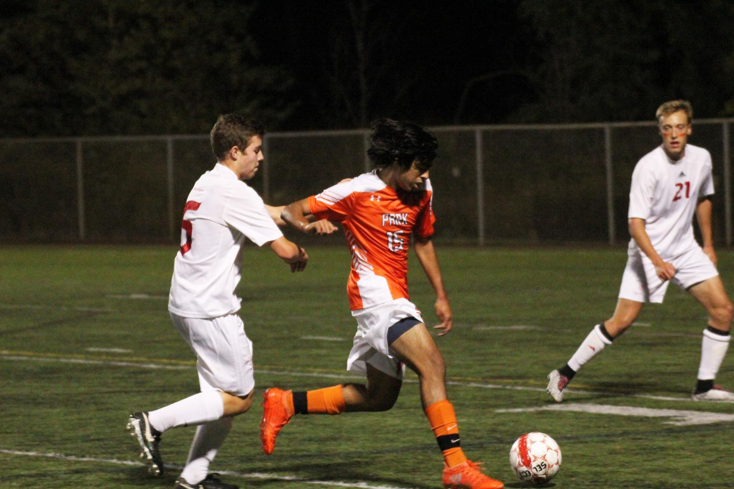Junior Fabio Leyva dribbles past a Benilde-St. Margaret's player during the Oct. 5 game. Park won the game 2-0, putting the boys' varsity team in first place in their conference.