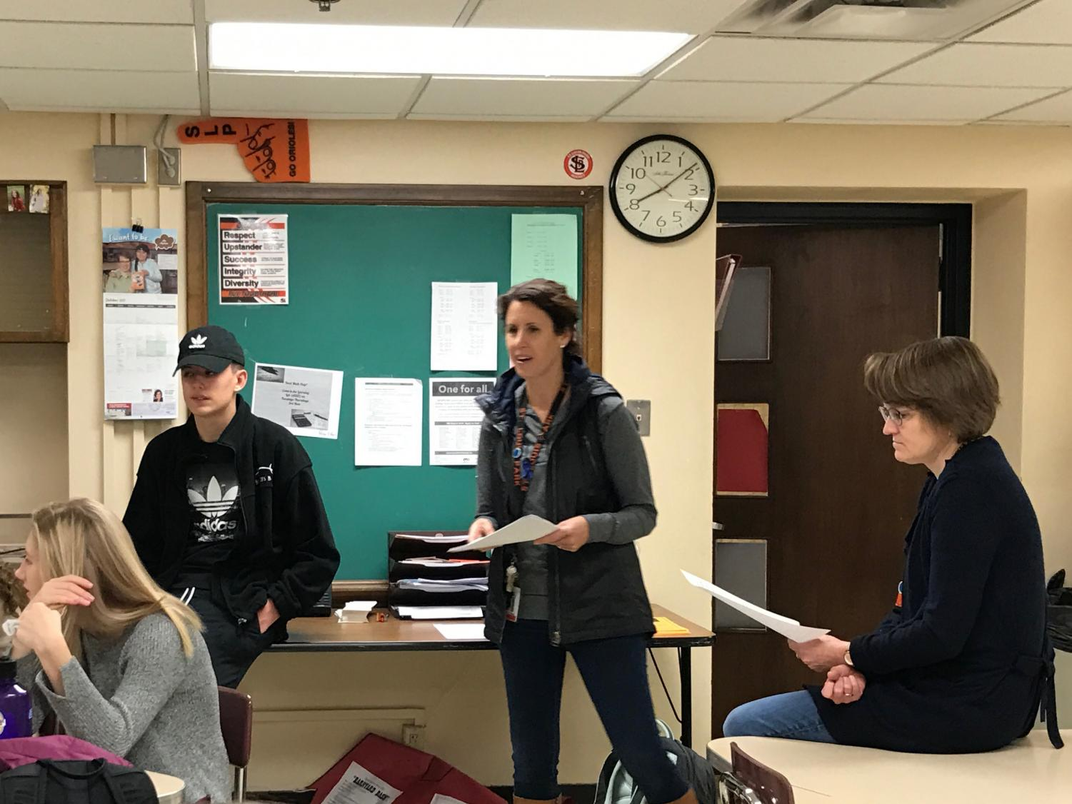 DECA co-advisers Sally Adams and Sophia Ross and senior officer Lewis Brown address DECA members attending the Fall Leadership Conference Oct. 27. The conference allows DECA chapters to bond within their chapters and with other Minnesota chapters.