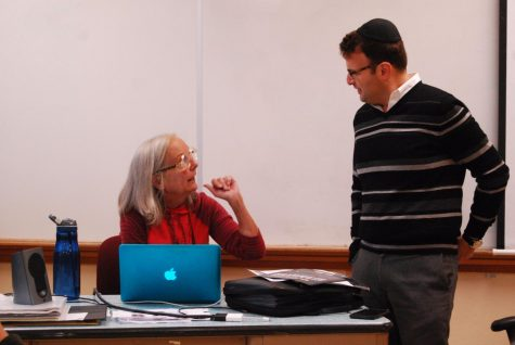 JSU adviser Mary Norris and Rabbi Tzvi Kupfer talk before the start of the meeting Nov. 26. The Jewish-Student Union is open to anyone and meets in A316 on Thursdays after school.