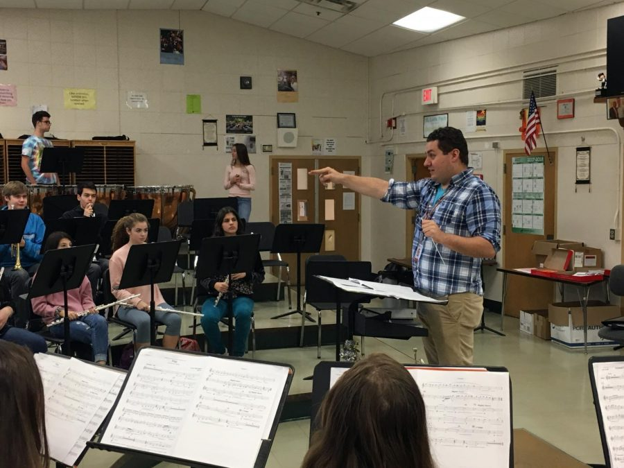 Band+student+teacher+Sam+Khwice+conducts+a+performance+during+third+hour+band+class+Oct.+25.+