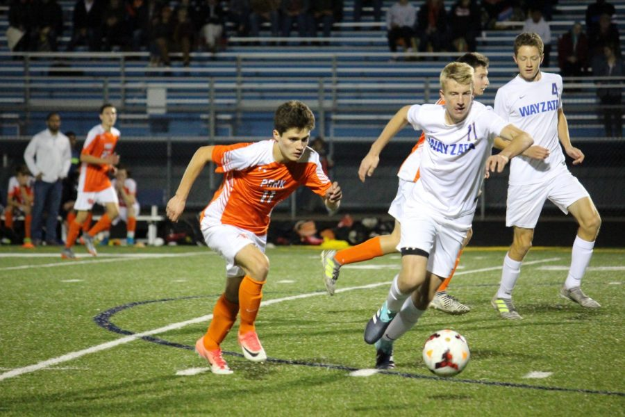 Sophomore Nick Riley fights for the ball against a Wayzata player. The Orioles lost 1-5 to Wayzata in the section final Oct. 17.