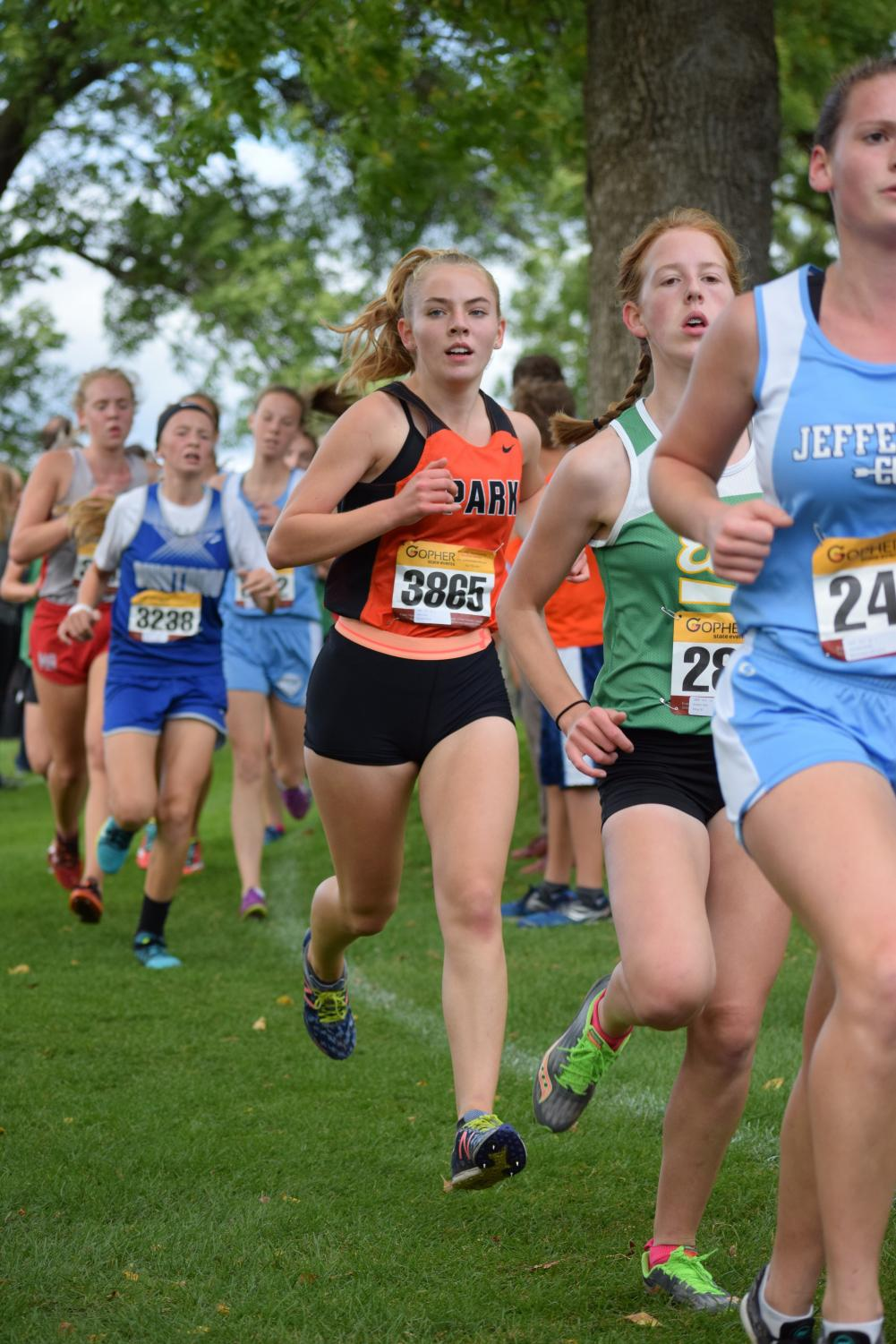 Sophomore Kaia Myers moves up in her position during the 5k race at the cross country conference meet. Photo used with permission by Jill Kraemer.