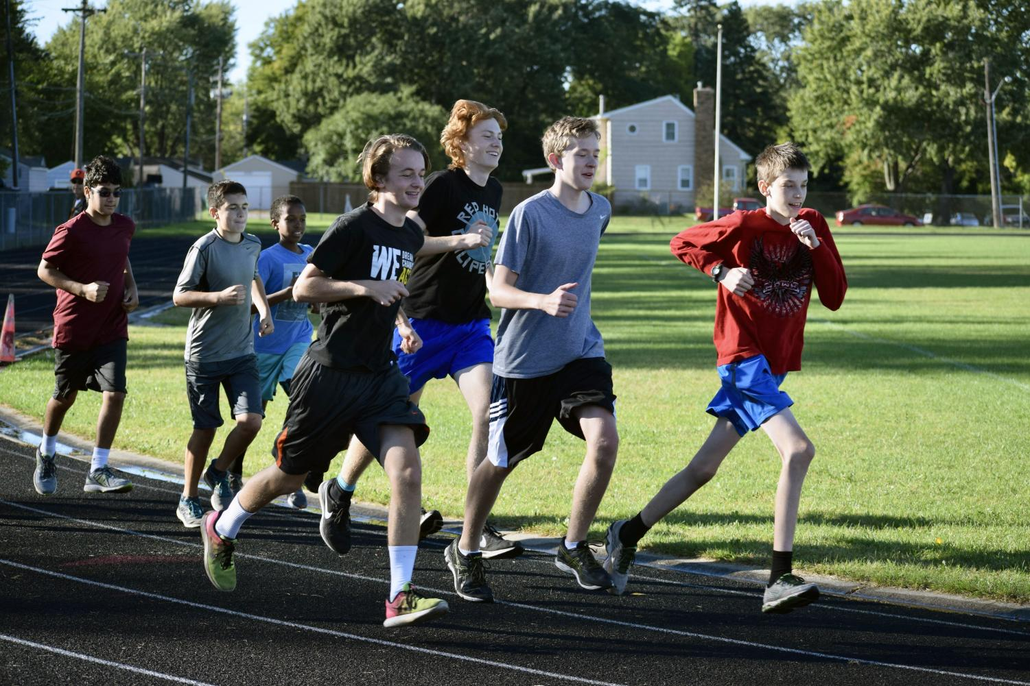 Cross country does an easy run around the track to conserve energy for their upcoming Sections meet. Photo used with permission by Jill Kraemer.